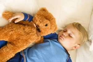 baby-sleeping-with-bear-39420-1